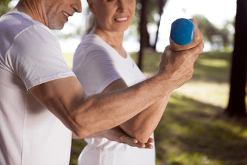 Bending elbow while holding hand weight stock photo