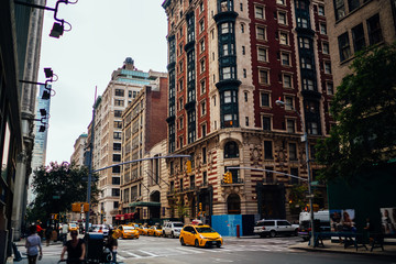 Foto auf AluDibond New York TAXI Big city life with traffic on roads and crowd on street near urban architecture building with apartments and offices,yellow cabs and autos driving on avenue passing high real estate for rent