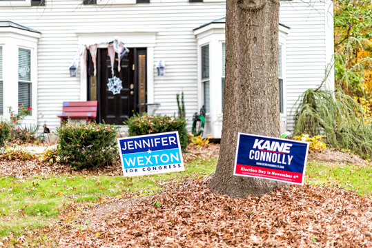 Herndon, USA - November 1, 2018: Political Election sign for Democrat Congress woman Jennifer Wexton representative on lawn, Tim Kaine, Connolly in Virginia, Halloween decorations