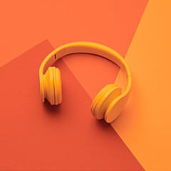 Minimal fashion, Trendy headphones. Music vibration on yellow geometry background. Hipster DJ...