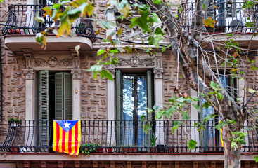 Catalonia flag on an old building balcony at the streets of Barcelona