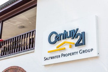 St. Augustine, USA - May 10, 2018: Sign for Century 21 Saltwater Property Real Estate group and nobody on street closeup in Florida city historic architecture