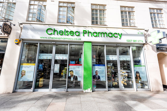 London, UK - June 24, 2018: Neighborhood borough of Chelsea street and exterior entrance to green Pharmacy medicine building and sidewalk