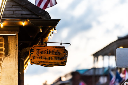 New Orleans, USA - April 22, 2018: Lafitte's blacksmith shop bar sign closeup in French Quarter Louisiana with illuminated lights in evening night