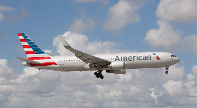 MIAMI, USA - JANUARY 26, 2016: American Airlines Boeing 767 landing at the Miami International Airport.