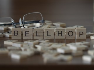 Bellhop the word or concept represented by wooden letter tiles