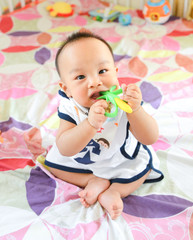Cute Asian little baby boy chewing teething