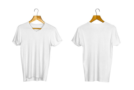 A white t-shirt hangs on a wooden hanger. Close up. Isolated on white background