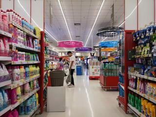 CHIANG RAI, THAILAND - NOVEMBER 16 : unidentified asian man walking at perspective view of supermarket interior on November 16, 2019 in Chiang Rai, Thailand.