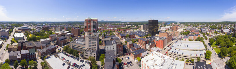 Manchester downtown building including City Hall Plaza and Brady Sullivan Plaza with Merrimack River at the background panorama aerial view, Manchester, New Hampshire, NH, USA.