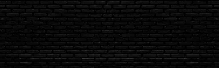 Abstract black brick wall texture for background or wallpaper design. panorama picture.