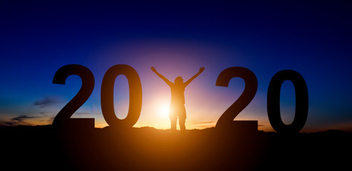 Silhouette of freedom businessman on the hill with number 2020 while celebrating new year. Wall mural