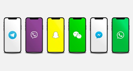Apple Iphone with different mobile instant messaging application logos: Telegram, Viber, Snapchat, WeChat, Facebook Messenger, Whatsapp