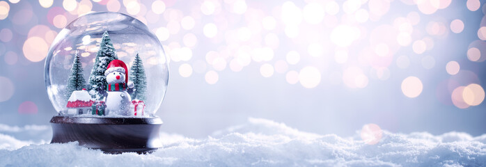 Snow globe on festive background Fotomurales