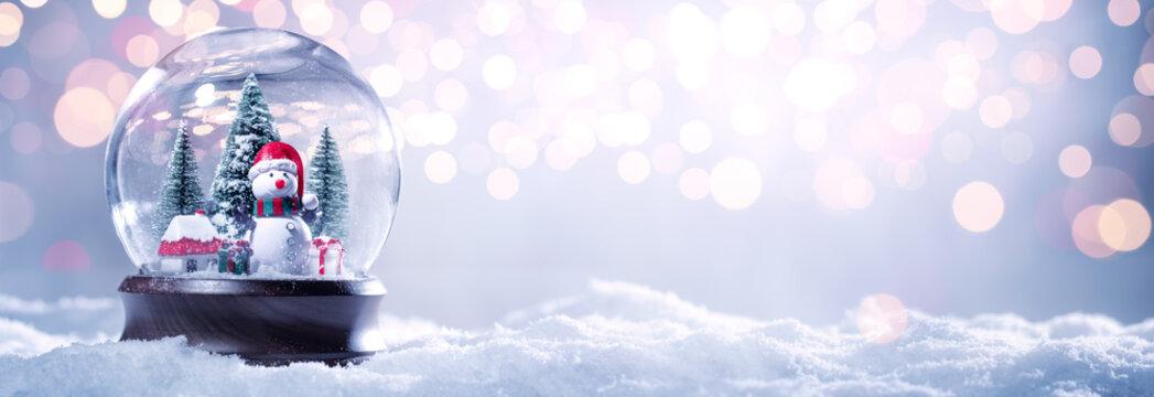 Snow globe on festive background