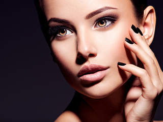 Face of a beautiful girl with fashion makeup and black nails Wall mural
