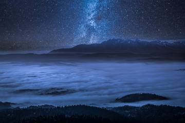 Fototapete - Stunning milky way and foggy walley in Tatra Mountains