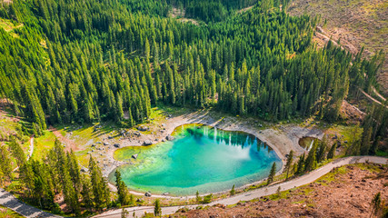 Aerial view of stunning Carezza lake in Dolomites, Italy Fotomurales