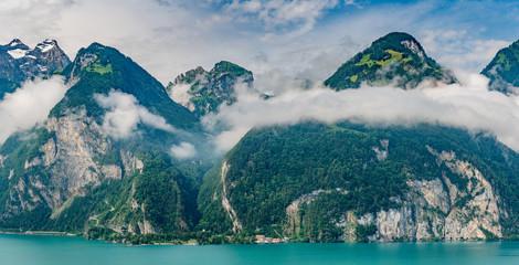 Switzerland, Panoramic view on green Swiss Alps and lake Lucerne near Isleten