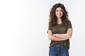 Cute confident successful young female diatologist with curly hair cross arms chest self-assured ready give helpful advice smiling broadly feel lucky day, standing white background