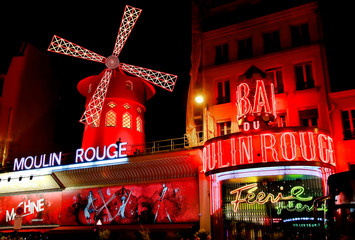 View of the Moulin Rouge (Red Mill) at night in Paris, France