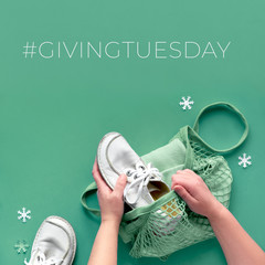Concept flat lay with hands packing shoes and clothes in mesh bag. Give goods on Giving Tuesday, participating in donation drive. Collect unwanted goods and pass them on to those in need.
