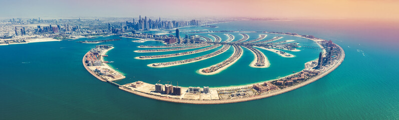 Aerial view on Palm Jumeira island in Dubai, UAE, on a summer day.