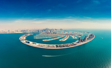 Spoed Fotobehang Dubai Aerial view on Palm Jumeira island in Dubai, UAE, on a summer day.