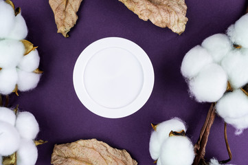 Jar of cream on a purple background. Mockup for your label. Natural cosmetics.