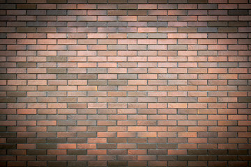 Bricks in the wall of a house as an abstract background