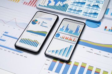 Mobilephones With Business Charts Fotobehang