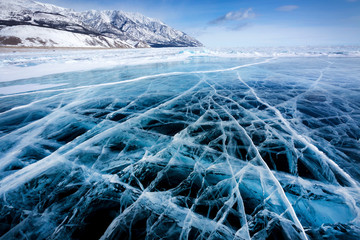 View of beautiful drawings on ice from cracks and bubbles of deep gas on surface of Baikal lake in winter, Russia Wall mural