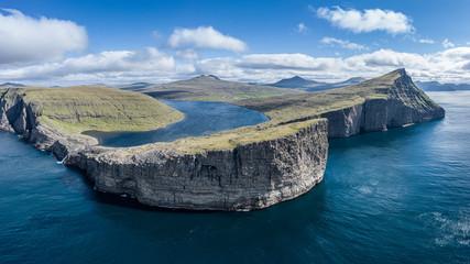 Leitisvatn lake and Bosdalafossur waterfall on Vagar island aerial view, Faroe Islands Fototapete