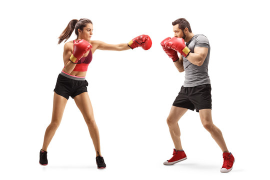 Young man and woman boxing