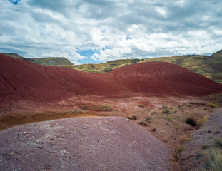 Brilliantly colored hills and riverbeds from the scenic Painted Cove Trail at the John Day Fossil Beds in Mitchell Oregon