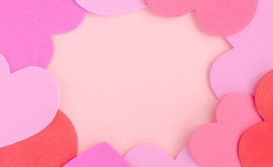 A pink and red love heart picture frame on a pink background representing Valentines day, romance and love