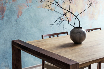 Close up of design wooden table with, stylish chairs, flowers in vase and elegant accessoreis....
