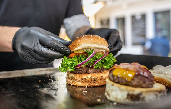 Preparing of fresh burger with potato fries chips on grill
