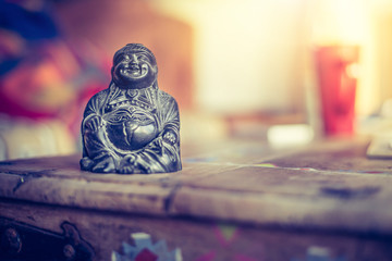 Spirituality and feng shui concept: Buddha statue in the living room. Relaxation, balance and spirituality.