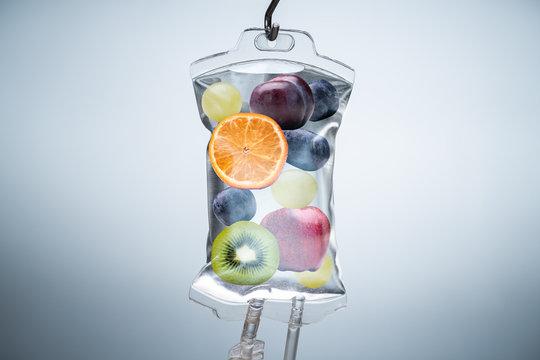 Different Fruit Slices Inside Saline Bag Hanging In Hospital