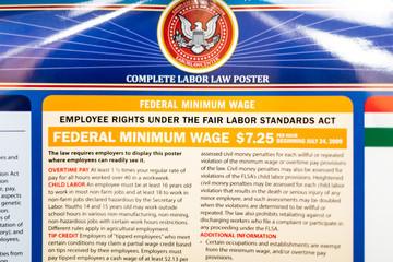 Fairfax, USA - September 29, 2018: Job Minimum Wage Labor Law regulations sign on board post poster information in Virginia office