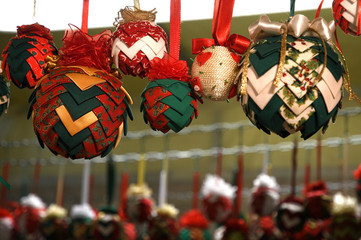 Handmade Christmas balls in a Christmas market in the center of Florence, Italy.