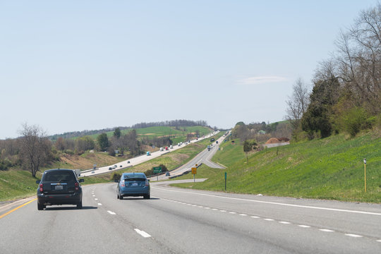Fairfield, USA - April 18, 2018: Cars driving on Interstate highway road 64 West in Virginia with view on hills and mountains in Shenandoah valley in summer or spring
