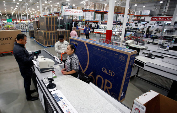 A shopper buys a television during the shopping season, 'El Buen Fin' (The Good Weekend), at a Costco store in the municipality of San Pedro Garza Garcia