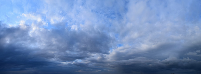 Printed roller blinds Panorama Photos Big summer clouds. Atmospheric phenomenon - the vapor state of water. Panoramic photo