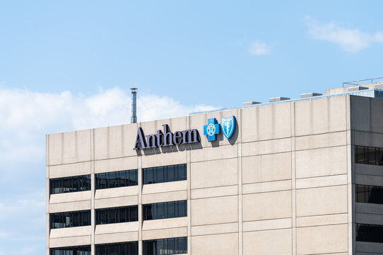Roanoke, USA - April 18, 2018: View of downtown city in Virginia closeup of building sign for Anthem health insurance