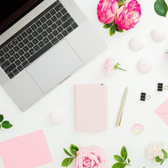 Laptop, roses, diary and envelope on white background. Flat lay.