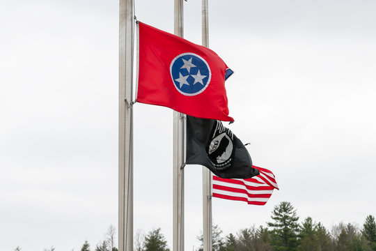 Walnut Hill, USA - April 19, 2018: Tennessee visitor's welcome center with row of state American and veteran flags closeup