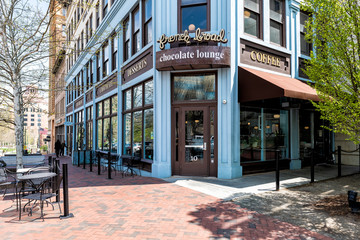 Asheville, USA - April 19, 2018: Downtown old town street in hipster North Carolina NC famous town with sign entrance to Chocolate Lounge