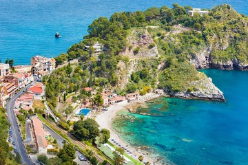 Clear blue sea, comfortable hotels and beach near Isola Bella in Taormina, Sicily, Italy